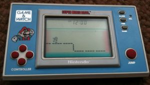 Super Mario Bross (1988, LCD, 2 LR/SR44 Batteries, Model#YM-105)